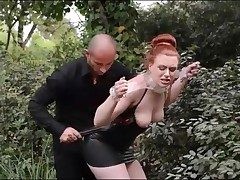 Skintight black leather sundress on bound redhead